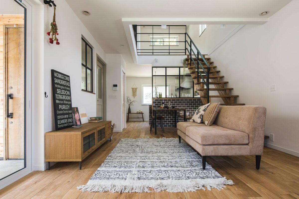GRAY TILE & GLASS WALL HOUSE